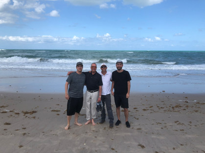 Film crew (left to right) Keenan Garrett, Barry Morrow, Nathan Edwards, and Spenser Sakurai between interviews in Vero Beach, FL