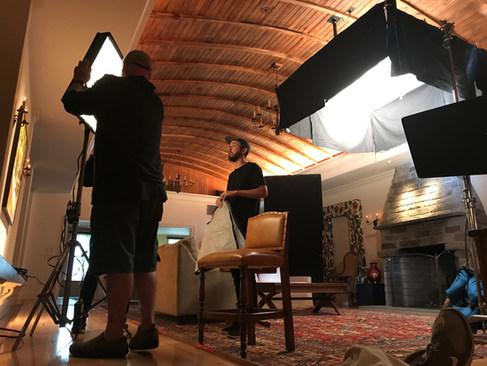 Cinematographer Spenser Sakurai sets up lighting for an interview