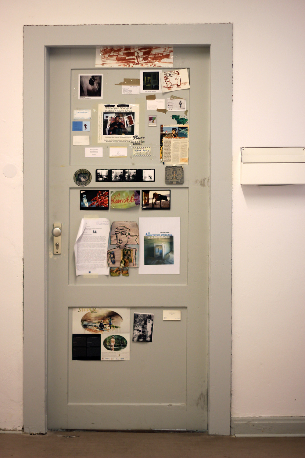 The front door of the apartment for the artists residency. With images and info from previous artists.