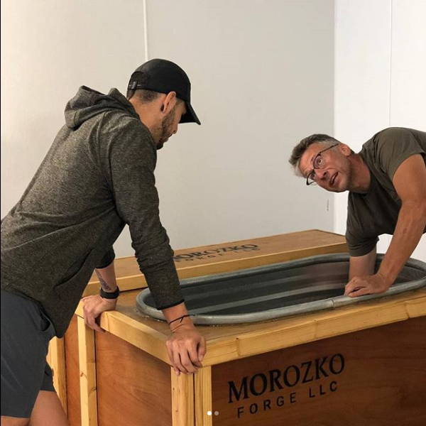 Two men inspect a Morozko Forge ice bath