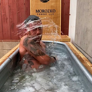 Former Navy SEAL Justin Hoagland shakes the cold water from his face during his deliberate cold exposure (DCE), in his Morozko Forge ice bath.