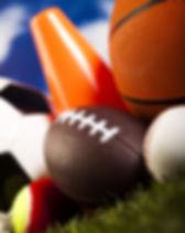 Assorted sports equipment and grass.jpg