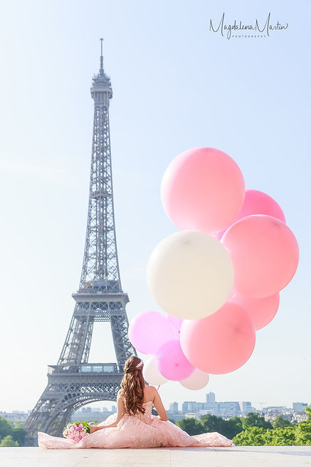 Girl in pink dress with balloons at the