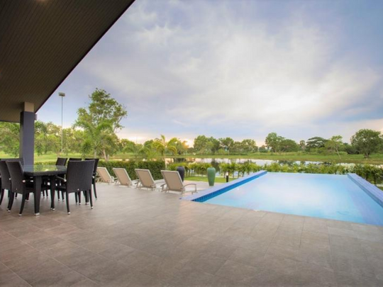13_Outdoor Dining overlooks  the pool.pn