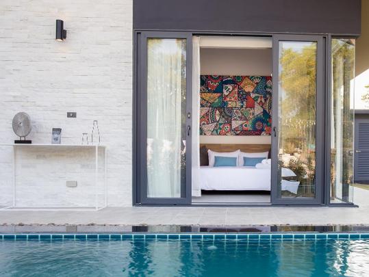 14_master bedroom overlooks swimming poo