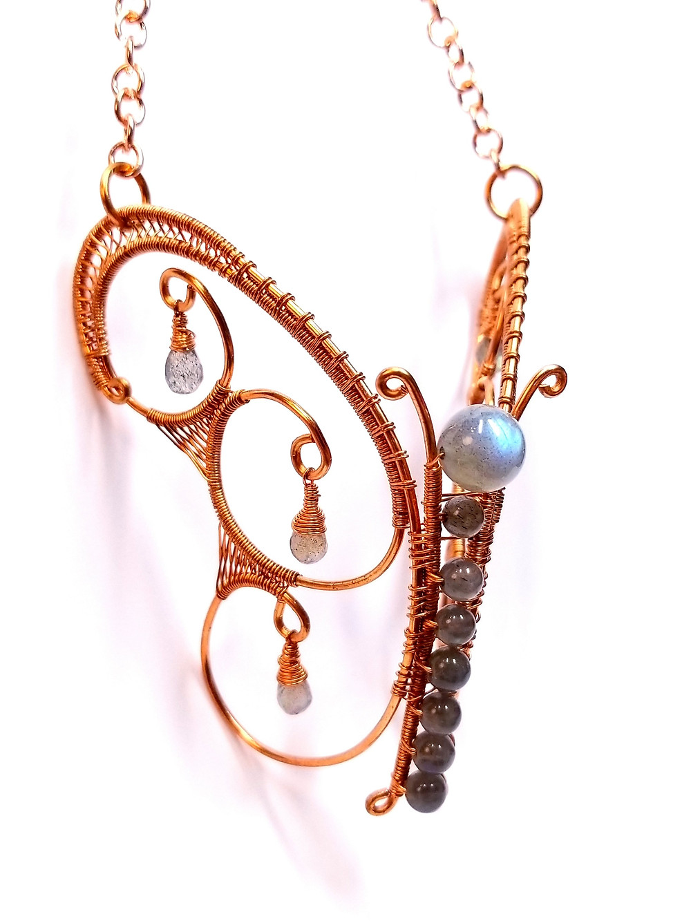 Copper wire weaving butterfly with labradorite accent beads.