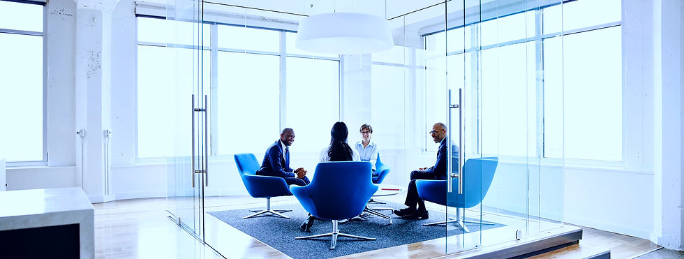 A group of four people meeting. The Copperline Group provides consulting services.