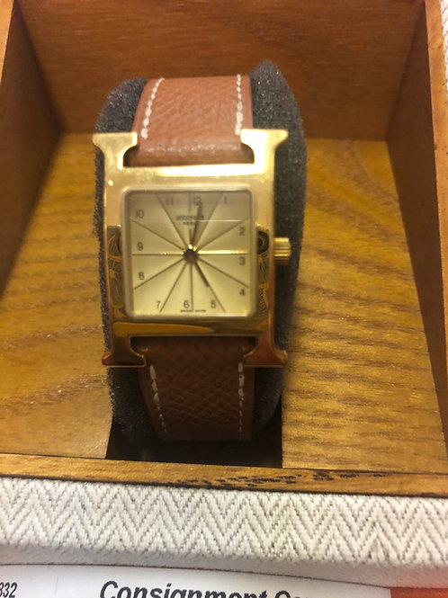 Hermès womens H watch in goldtone & leather band