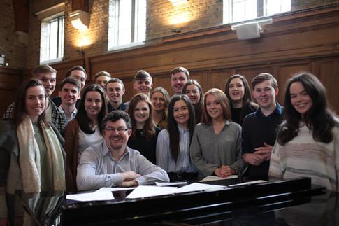 DE FAV choir at piano in MH REHEARSAL 1.