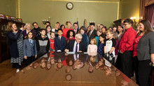 President of Creative Kids Rock with Governor Evers as he signs 1st Dysleixa Law ACT 86