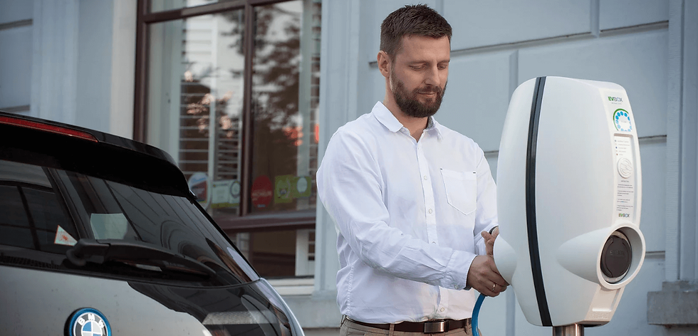 Man charging electric vehicle with EVBox BusinessLine