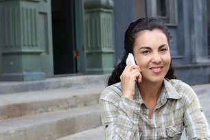 Woman on her cellphone smiling