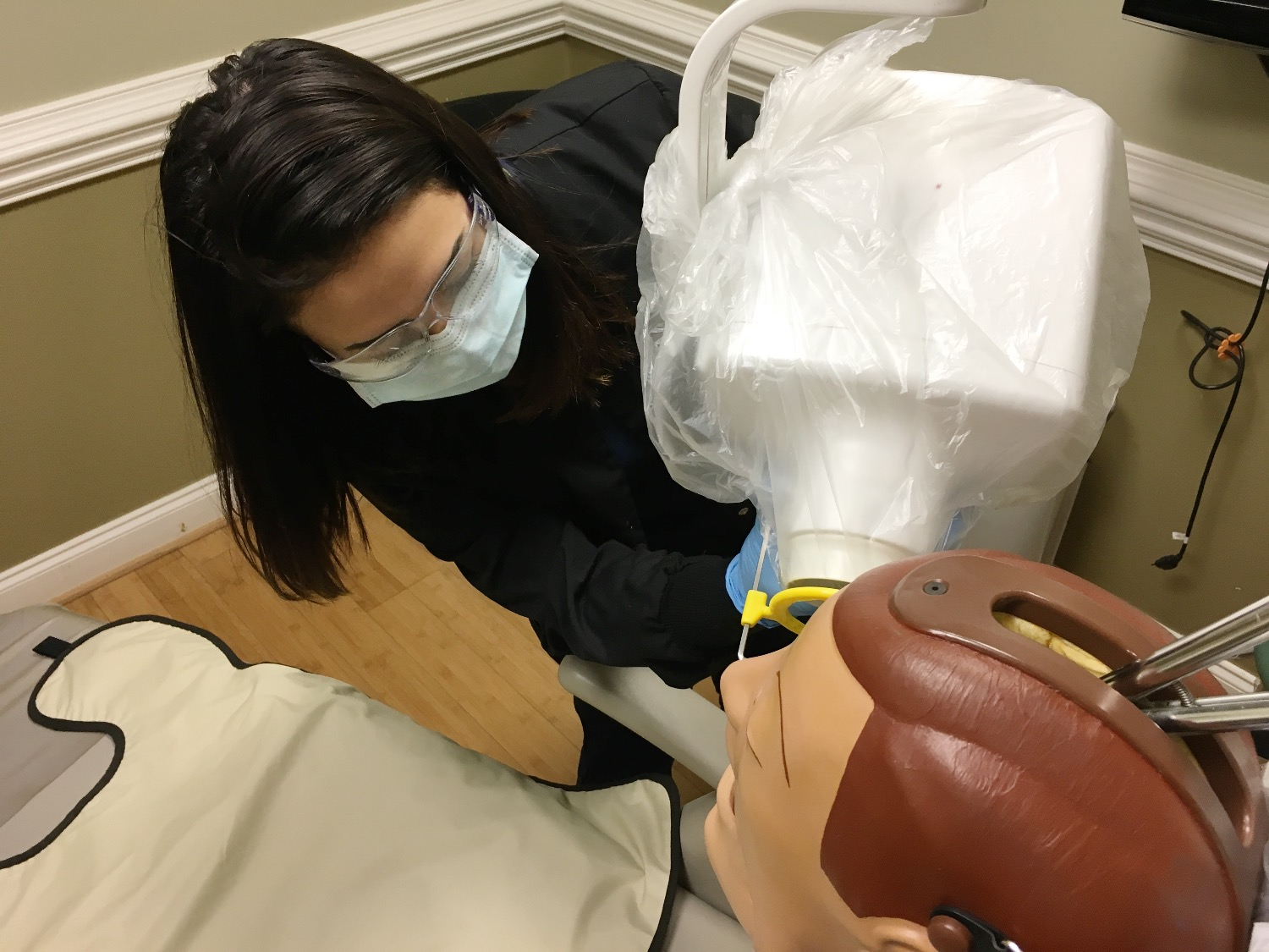 Dental Assistant Placing X-ray