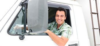 portrait-of-a-happy-truck-driver-deliver