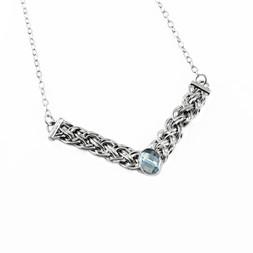 N38 - Sterling silver basket weave necklace with sky blue topaz lying.jpg