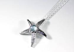 Custom made fine silver starfish pendant set with faceted aquamarine