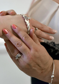 Custom Claddagh bangle being put on brides wrist