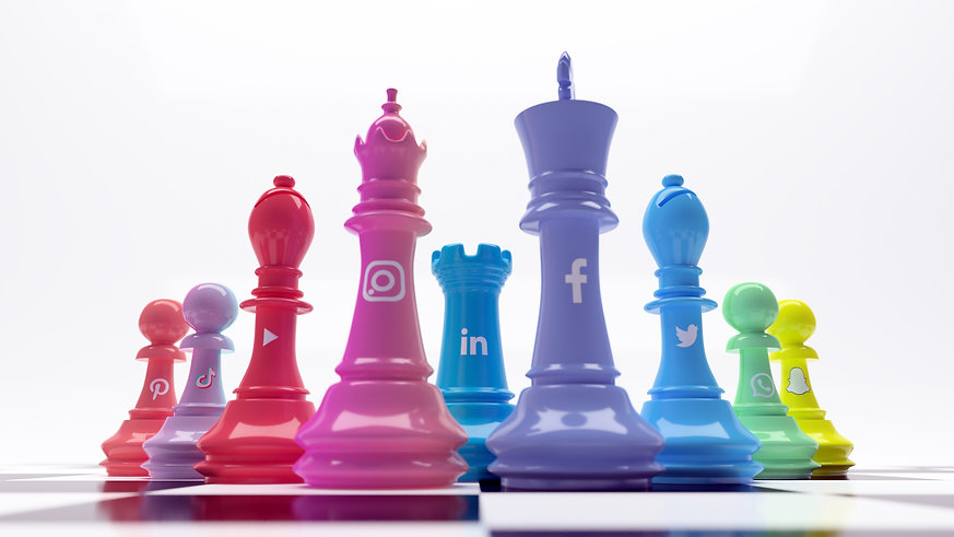 Multi coloured chess set with social media icons representing marketing strategy