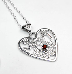 Custom made sterling silver heart pendant featuring initials and garnet