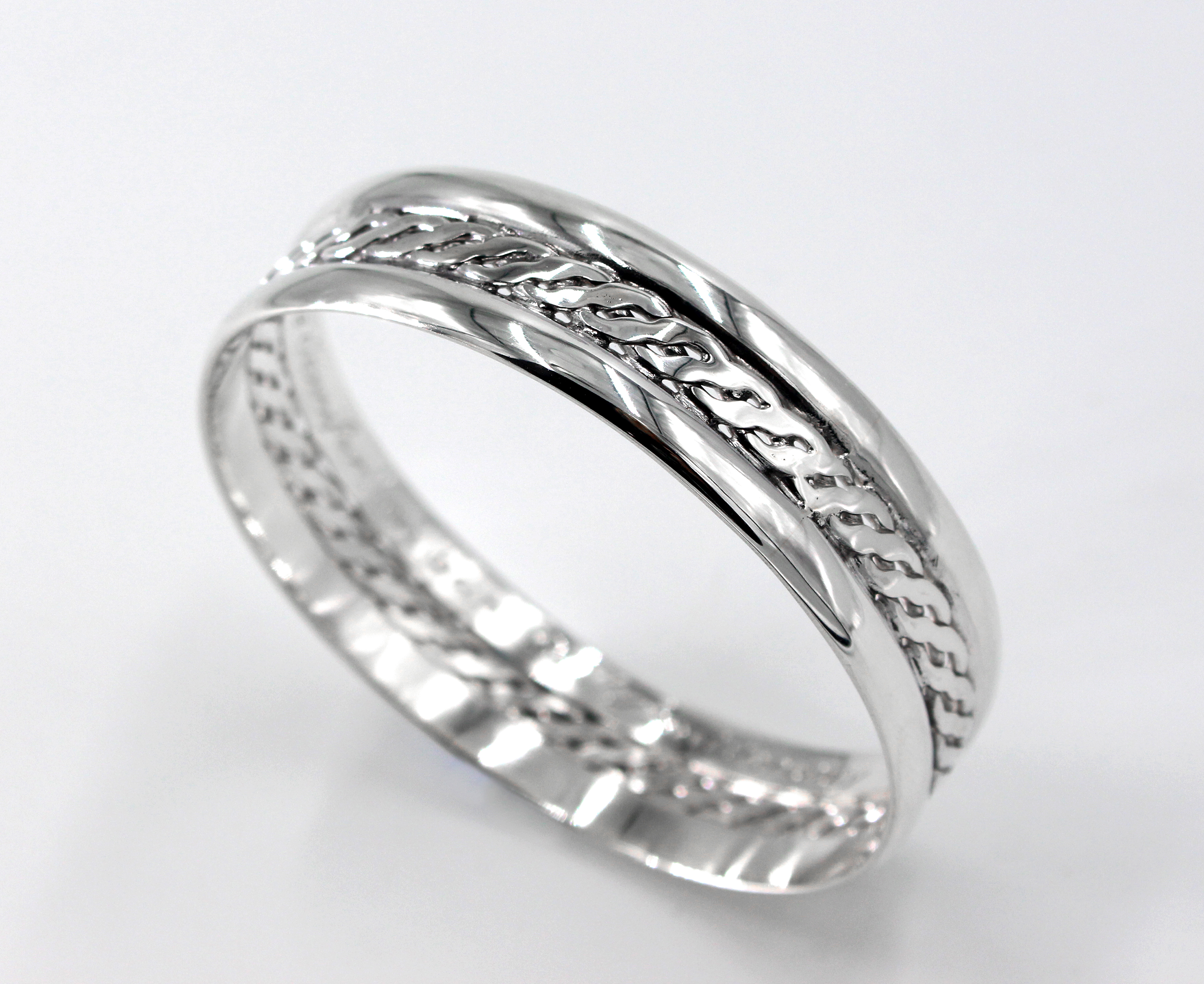 Wide sterling silver bangle with a woven centre and engraved message