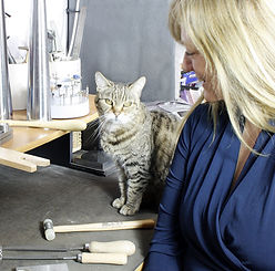 Jayne Robb of Woven Art Jewellery with her workshop helpmate Jess the cat