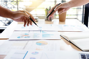 Marketing documents and graphs on a meeting room table