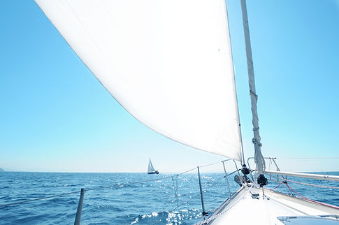 front of sailboat on water