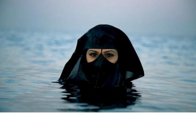 Image from Saudi Arabia Photographer Sebastian Farmborough went to Saudi Arabia and saw this woman out at sea. © Sebastian Farmborough