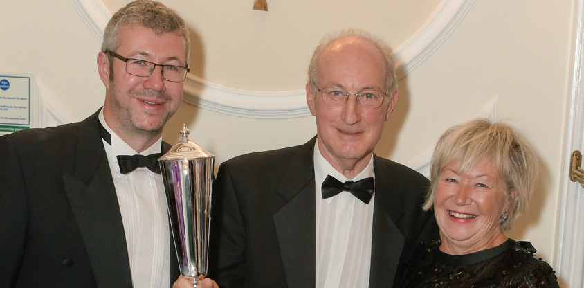 Mike Turpin receiving the Mike Hall Memorial Trophy from Kath and Will Hall