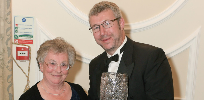 Will Hall receiving the Tony Fletcher Memorial Trophy from Rosie Boucher
