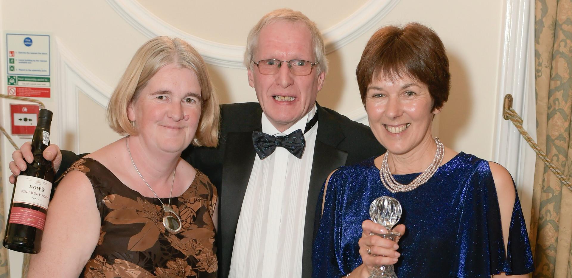 Terry and Tricia Davis receiving the Pilbeam Mick Howlett Award from Sue Fletcher