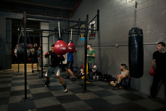 Boxers in different stages of their workout