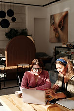 women-having-meeting-at-the-coffee-shop-