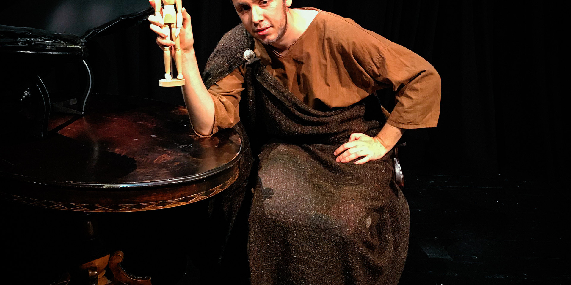 Photo of Daniel on stage for a theater monologue