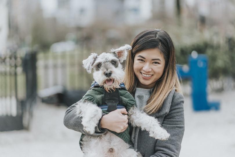 Dog-mom with her dog having fun