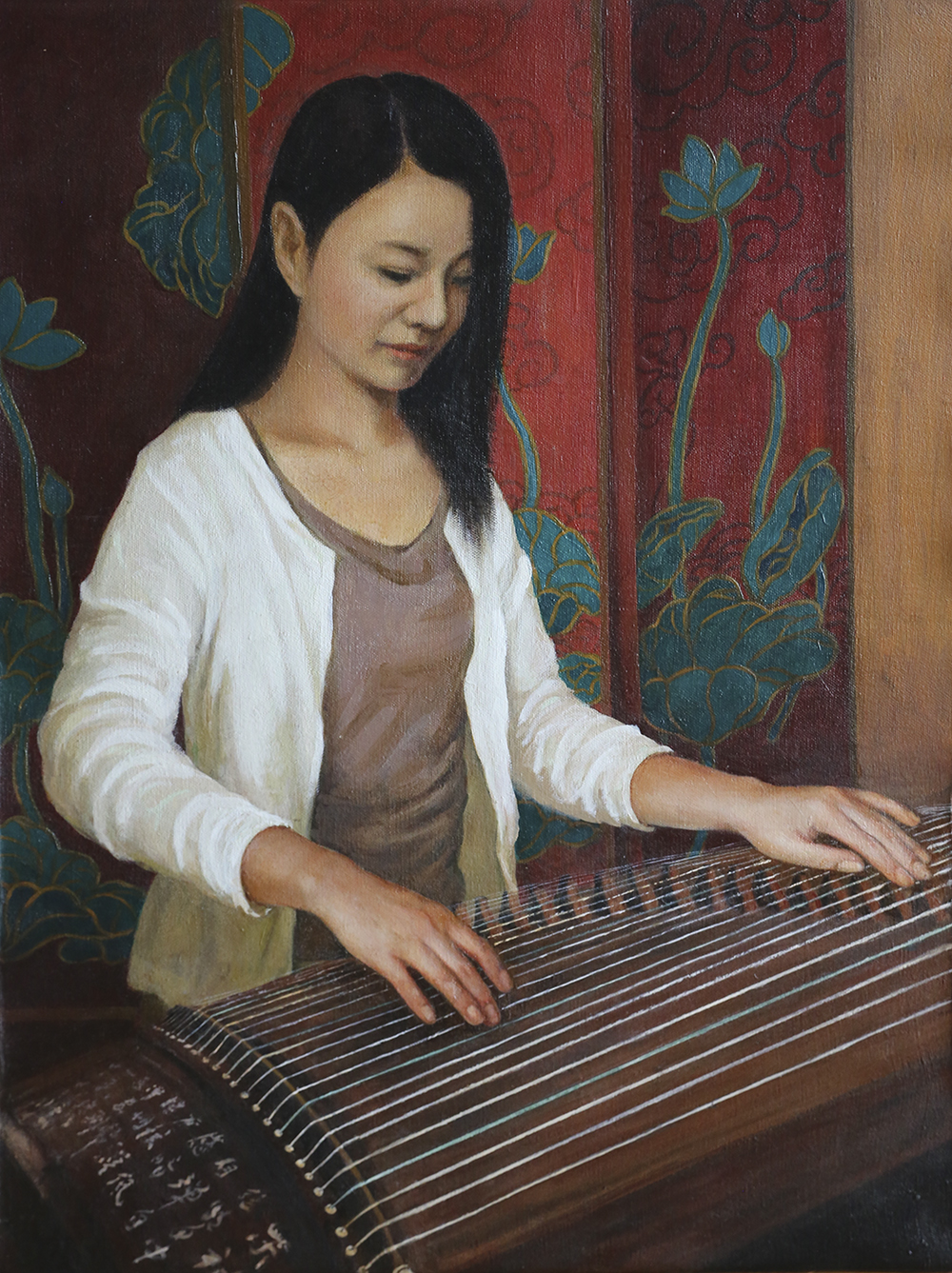 Lady playing Guzheng