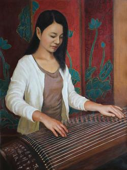 Lady playing Guzheng
