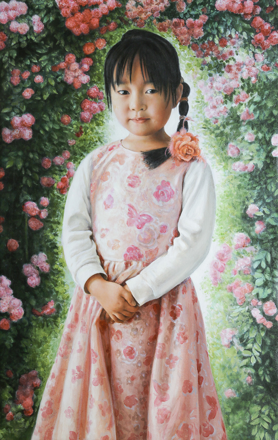 Girl in blooming rose bush
