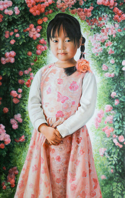 Girl in blooming rose bush