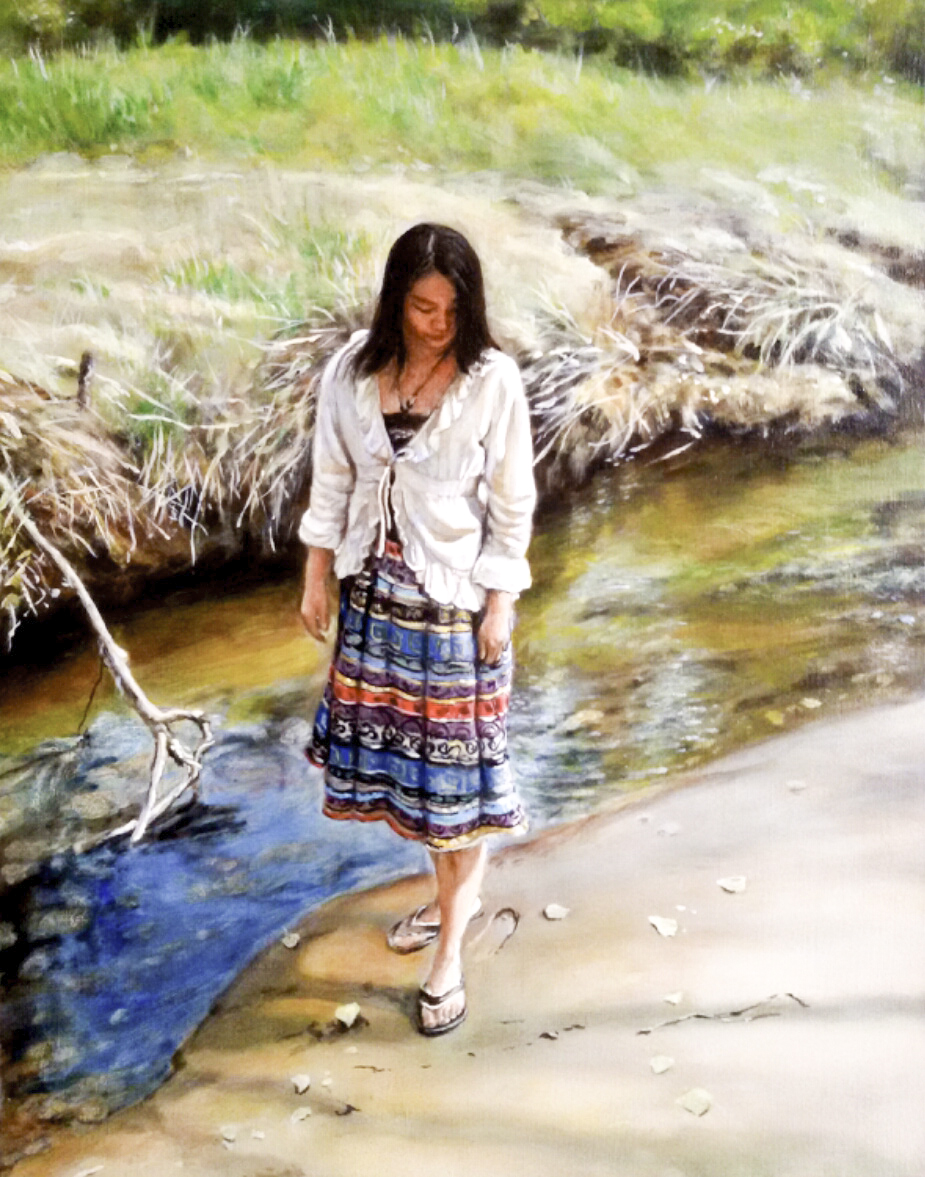 Lady by a riverbank