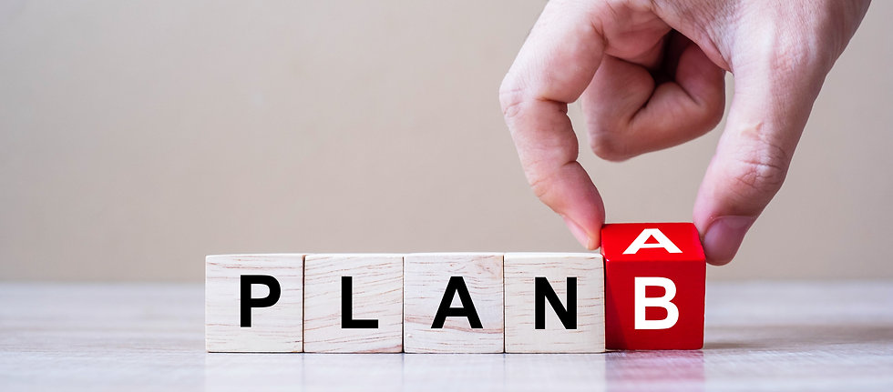 Businessman hand flipping wooden cube blocks with PLAN A change to PLAN B text on table ba