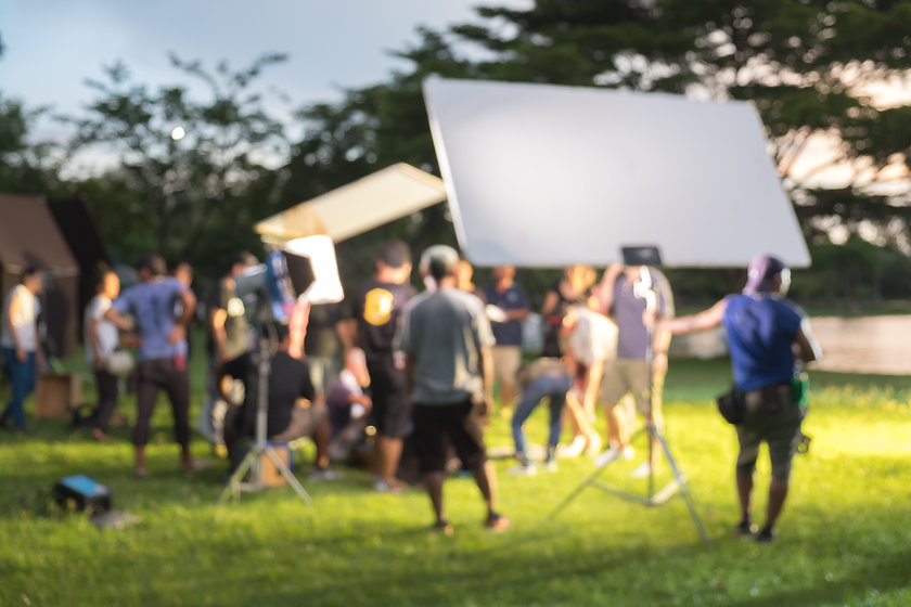 Blurred Busy outdoor filming production crew team.jpg