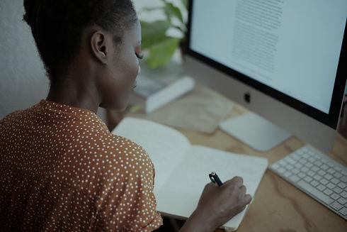 woman-writing-on-her-notebook-3059747_edited.jpg