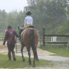 Sohia, Ava, and I walking in rain at sho
