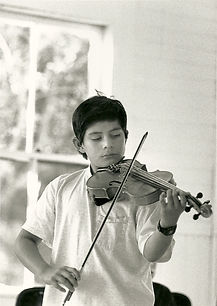 Boy playing violin in lesson