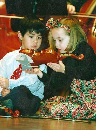 Suzuki students look inside violin