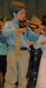 Violin student playing in group cocert