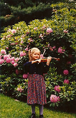 Suzuki violin student practicing in garden