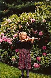 Suzuki violin student practicing in garden