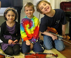 Violin students smile in group class
